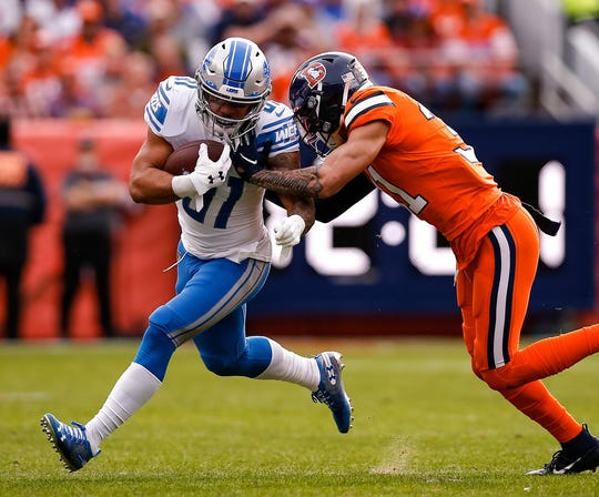 Lions running back Ty Johnson runs the ball as he is pushed out of bounds by Broncos free safety Justin Simmons in the first quarter on Sunday, Dec. 22, 2019, in Denver.
