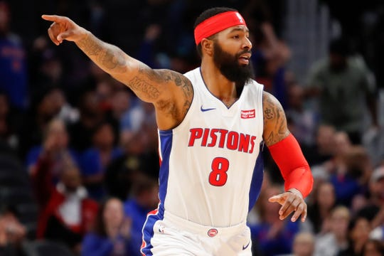 Detroit Pistons forward Markieff Morris (8) points down the court after making a shot during the first quarter against the Chicago Bulls at Little Caesars Arena on Saturday, Dec. 21, 2019.