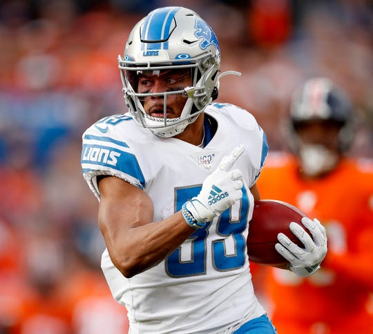 Lions cornerback Jamal Agnew runs a punt return back for a 64-yard touchdown against the Broncos during the first half on Sunday, Dec. 22, 2019, in Denver.