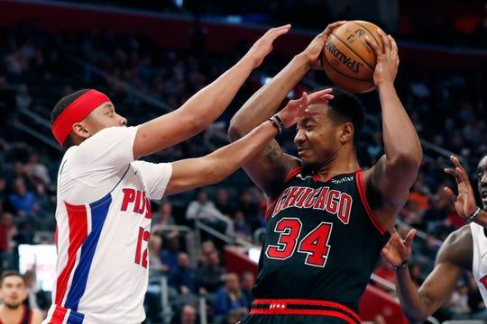 Pistons guard Tim Frazier (12) fouls Bulls center Wendell Carter Jr.