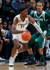 Michigan State's Aaron Henry, left, had 12 points, nine rebounds and six assists Saturday night against Eastern Michigan.