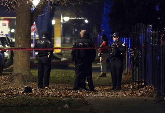 Chicago police guard a crime scene in the 5700 block of S. May Street after several people were shot there on Sunday, Dec. 22, 2019.