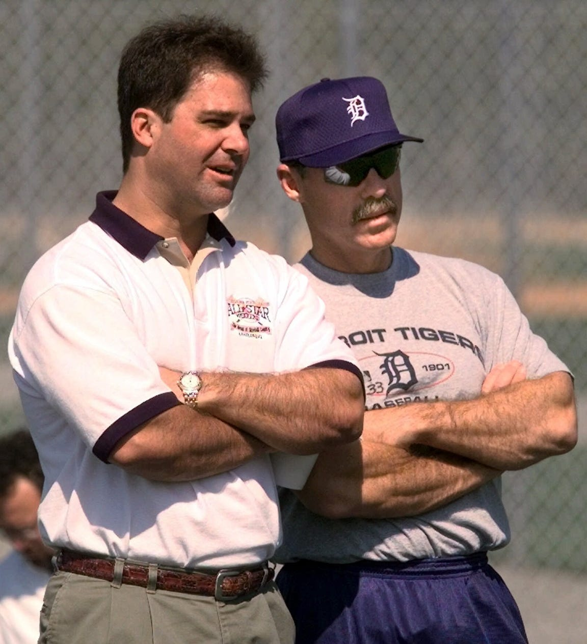 Tigers general manager Randy Smith chats with manager Phil Garner as they watch minor league pitchers throw in February 2000, in Lakeland, Fla.