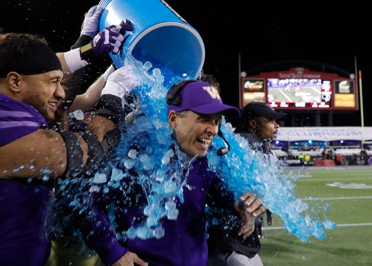 Washington coach Chris Petersen is doused during the team's Las Vegas Bowl triumph.