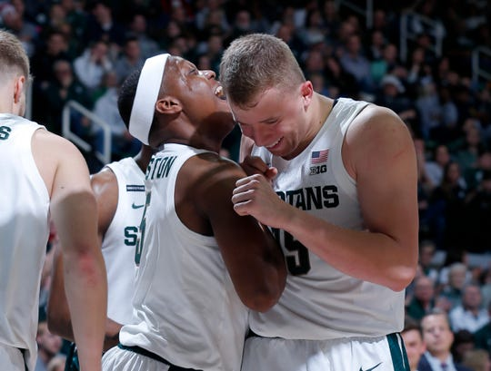Michigan State's Cassius Winston, left, celebrates with Thomas Kithier during Saturday's 101-48 win over Eastern Michigan.