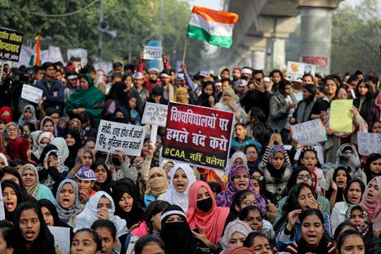 Indian students of the Jamia Millia Islamia University and locals participate in a protest demonstration against a new citizenship law in New Delhi, India, Saturday, Dec. 21, 2019.