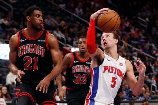 Detroit Pistons guard Luke Kennard (5) looks to pass around the defense of Chicago Bulls forward Thaddeus Young (21) during the first half.