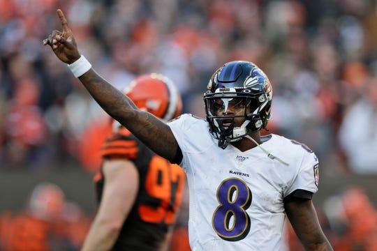 Ravens quarterback Lamar Jackson gives a signal during the second half on Sunday.
