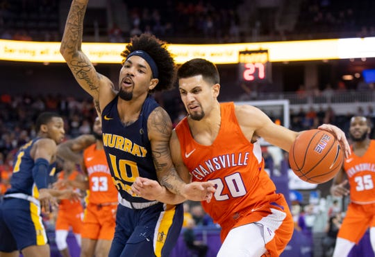 Evansville's Sam Cunliffe (20) drives the baseline against Murray State's Tevin Brown (10) during their game at Ford Center in Evansville, Ind., Saturday, Dec. 21, 2019.