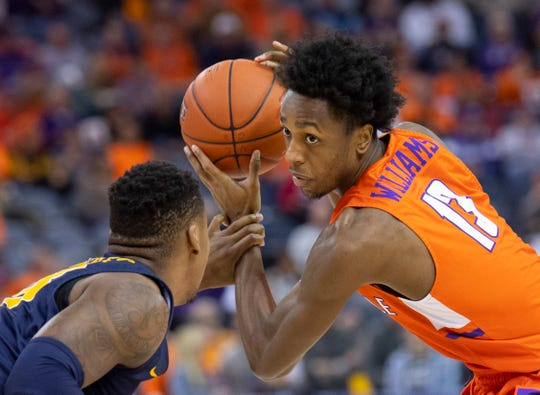 Evansville's DeAndre Williams (13) is defended by a Murray State player during their game at Ford Center in Evansville, Ind., Saturday, Dec. 21, 2019.