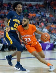 Evansville's K.J. Riley (33) drives against Murray State's Devin Gilmore (13) during their game at Ford Center in Evansville, Ind., Saturday, Dec. 21, 2019.