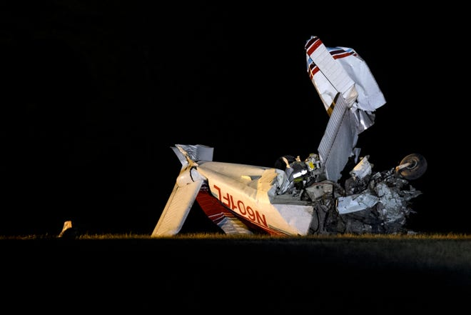 The scene of a small plane crash that killed the pilot who, according to the Vanderburgh County Sheriff's Office was the only one inside, on the grounds of Camp Reveal, along East Boonville-New Harmony Rd, in Evansville, Ind., Saturday, Dec. 21, 2019.