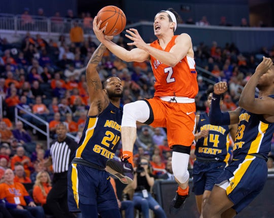 Evansville's Artur Labinowicz (2) splits the Murray State defense for two points during their game at Ford Center in Evansville, Ind., Saturday, Dec. 21, 2019.