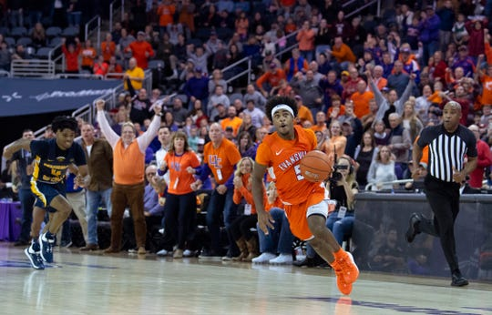 Evansville's Shamar Givance (5) runs out the overtime clock against Murray State during their game at Ford Center in Evansville, Ind., Saturday, Dec. 21, 2019.