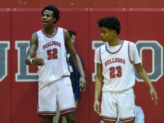Bosse's Kiyron Powell (52) and Bosse's Julian Norris (23) prepare to keep the Gary West Side Cougars from scoring with 10 seconds remaining in the Bosse Winter Classic Shootout in Evansville, Saturday evening, Dec. 21, 2019. The Bulldogs defeated the Cougars, 57-56.
