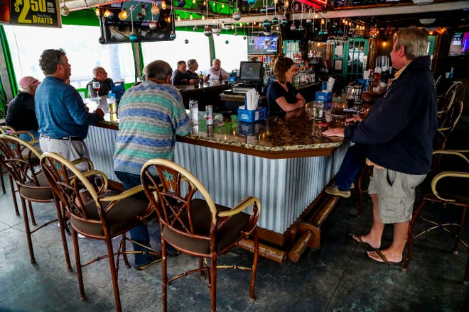 Claudai Garcia, owner, bought, reopened and rebranded Monkey Bar 13 years ago after it was shut down due to Hurricane Charley. Juan Rincon, is the Restaurant Manager.