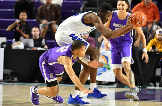 IMG Academy Mark Williams tries to get around Gonzaga defender Malcolm Dread in the City of Palms Classic in Fort Myers ,Saturday, Dec. 21, 2019.
