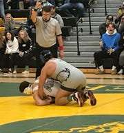 Great Falls High's Ethan DeRoche gets the winning two-point takedown in sudden victory overtime to defeat Kameron Moreno of Butte for the heavyweight championship of the CMR Holiday Classic last month.