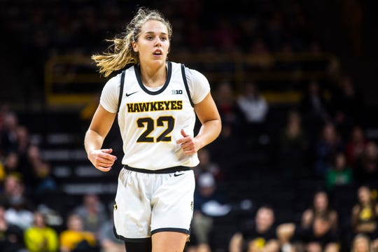 Iowa guard Kathleen Doyle (22) settles in on defense after making a 3-point basket during a NCAA non-conference women's basketball game, Saturday, Dec. 21, 2019, at Carver-Hawkeye Arena in Iowa City, Iowa.