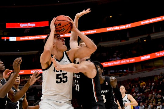 Iowa center Luka Garza (55) shoots against Cincinnati center Chris Vogt (33) during the first half of Saturday at the United Center in Chicago.