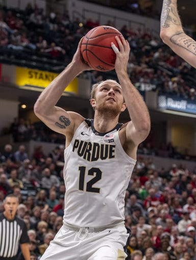 Purdue forward Evan Boudreaux (12) makes a move from under the basket during the second half of game two against Butler of the 2019 Crossroads Classic, Saturday, Dec. 21, 2019, at Bankers Life Fieldhouse. Butler won 70-61.