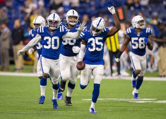 Indianapolis Colts cornerback Pierre Desir (35) celebrates with his teammates after pulling in a game-ending pass interception during the second half of an NFL football game against the Carolina Panthers, Sunday, Dec. 22, 2019, at Lucas Oil Stadium. The Colts won 38-6.