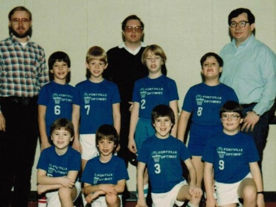 Nate Muterspaugh (front row second from left) made his first basket in a game with a trick shot.