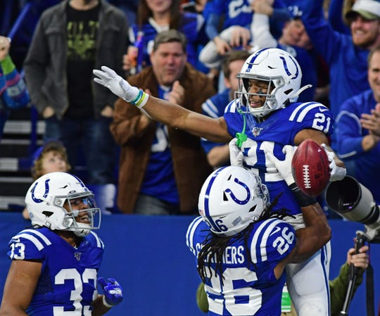 Dec 22, 2019; Indianapolis, Indiana, USA;  Indianapolis Colts running back Nyheim Hines (21) celebrates his kick-off run for a touchdown against the Carolina Panthers in the first half at Lucas Oil Stadium.