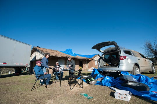 The Blackwell family, from left, Reggie Blackwell, Ann Blackwell, their son-in-law Trey Day and their daughter Regina Day take a break for lunch Thursday, Dec. 19, 2019. The Blackwells lost their house and chicken farm when tornadoes cut through MIze Monday, Dec. 16, 2019.
