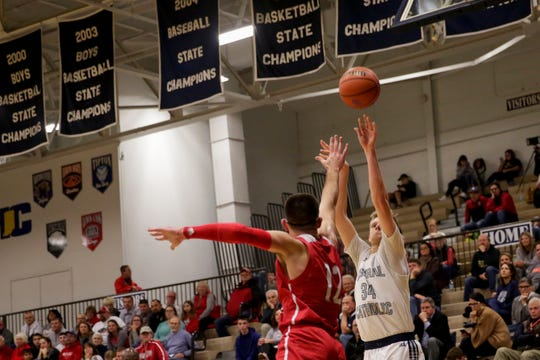 Carson Barrett had 11 points and 12 rebounds in Central Catholic's win over Clinton Prairie.
