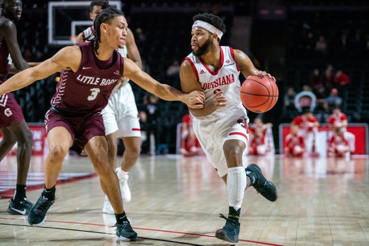 UL's Trajan Wesley makes a drive to the goal as the Ragin' Cajuns take on the Little Rock Trojans at the Cajundome on Saturday, Dec. 21, 2019.