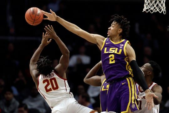 LSU forward Trendon Watford (2) blocks a shot from Southern California guard Ethan Anderson (20) during the second half of an NCAA college basketball game Saturday, Dec. 21, 2019, in Los Angeles. (AP Photo/Marcio Jose Sanchez)