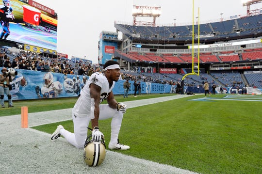 New Orleans Saints defensive back Chauncey Gardner-Johnson kneels on the field before an NFL football game against the Tennessee Titans Sunday, Dec. 22, 2019, in Nashville, Tenn. (AP Photo/Mark Zaleski)