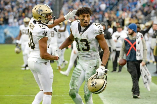 New Orleans Saints wide receiver Michael Thomas (13) is congratulated by Tre'Quan Smith (10) after Thomas made a catch against the Tennessee Titans in the second half of an NFL football game Sunday, Dec. 22, 2019, in Nashville, Tenn. The catch gave Thomas the NFL single-season pass reception record. (AP Photo/Mark Zaleski)
