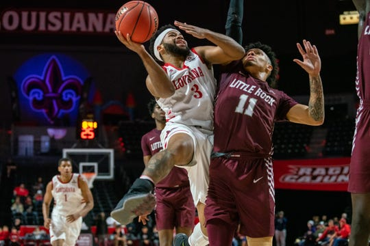 UL point guard Trajan Wesley takes the ball to the basket against Little Rock earlier this season at the Cajundome.