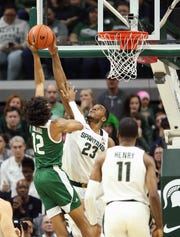 Dec 21, 2019; East Lansing, MI, USA; Michigan State Spartans forward Xavier Tillman (23) blocks the shot of Eastern Michigan Eagles guard Shamar Dillard (12) during the second half of a game at the Breslin Center. Mandatory Credit: Mike Carter-USA TODAY Sports