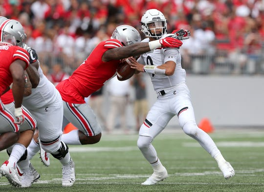 Ohio State defensive end Tyreke Smith sacks Cincinnati quarterback Desmond Ridder during a game earlier this season in Ohio Stadium.