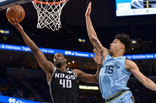 Sacramento Kings forward Harrison Barnes (40) shoots against Memphis Grizzlies forward Brandon Clarke (15) in the first half of an NBA basketball game Saturday, Dec. 21, 2019, in Memphis, Tenn. (AP Photo/Brandon Dill)
