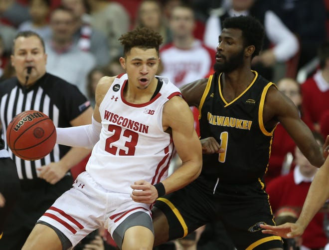Badgers guard Kobe King works against UWM guard Deandre Abram.