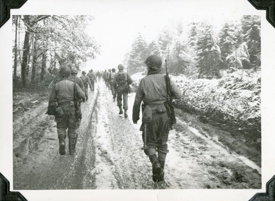 American soldiers walk through the Hurtgen Forest during the Battle of the Bulge in 1944.