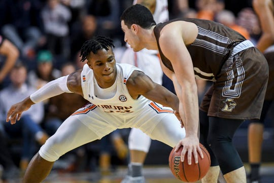 Auburn forward Isaac Okoro (23) attempts to steal the ball from Lehigh guard Jordan Cohen (11) during the second half of an NCAA college basketball game Saturday, Dec. 21, 2019, in Auburn, Ala. (AP Photo/Julie Bennett)