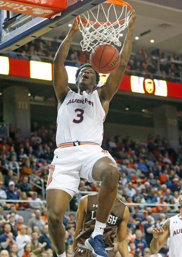 Dec 21, 2019; Auburn, Alabama, USA; Auburn Tigers forward Danjel Purifoy (3) makes a dunk against the Lehigh Mountain Hawks during the second half at Auburn Arena. Mandatory Credit: John Reed-USA TODAY Sports