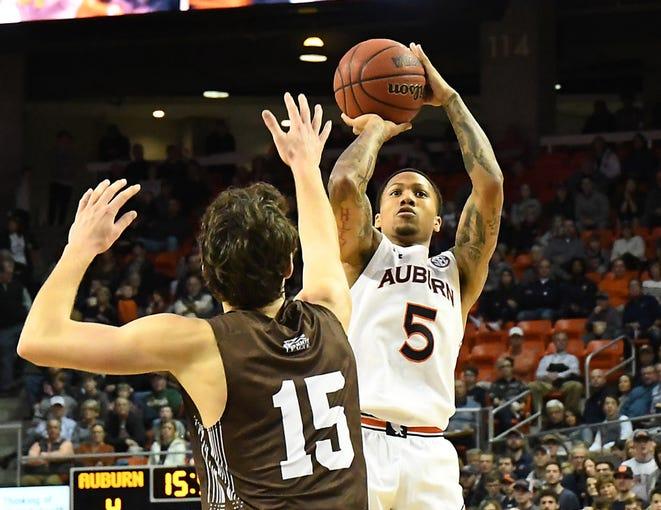 Auburn's J'Von McCormick (5) shoots during the first half against Lehigh on Saturday, December 21, 2019 in Auburn, Ala.  Anthony Hall/Auburn Athletics