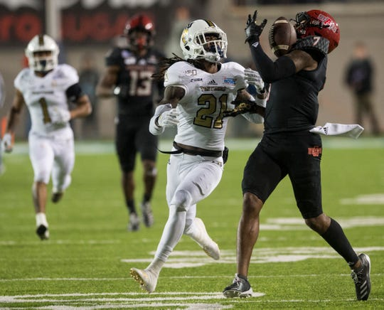 Arkansas State wide receiver Omar Bayless (7) pulls in a long pass during the Camellia Bowl at Cramton Bowl in Montgomery, Ala., on Saturday, Dec. 21, 2019. Arkansas State leads Florida International 20-13 at halftime.