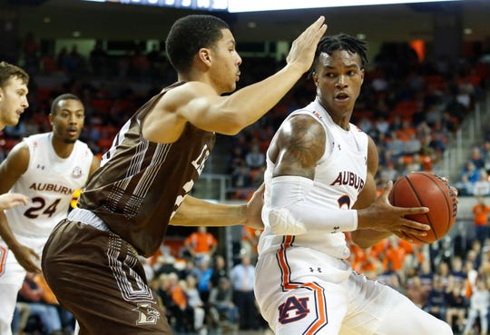 Dec 21, 2019; Auburn, Alabama, USA; Auburn Tigers guard Allen Flanigan (22) is pressured by Lehigh Mountain Hawks guard Marques Wilson (20) during the second half at Auburn Arena. Mandatory Credit: John Reed-USA TODAY Sports
