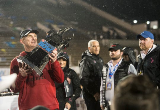 Arkansas State head coach Blake Anderson hoists the trophy during the Camellia Bowl at Cramton Bowl in Montgomery, Ala., on Saturday, Dec. 21, 2019. Arkansas State defeated Florida International 34-26.