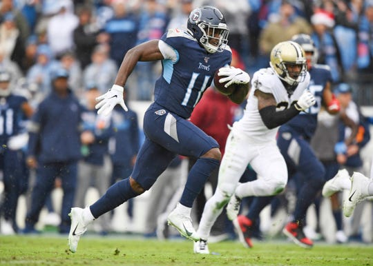 Tennessee Titans wide receiver A.J. Brown (11) runs in a touchdown against the New Orleans Saints during the first quarter at Nissan Stadium Sunday, Dec. 22, 2019 in Nashville, Tenn.