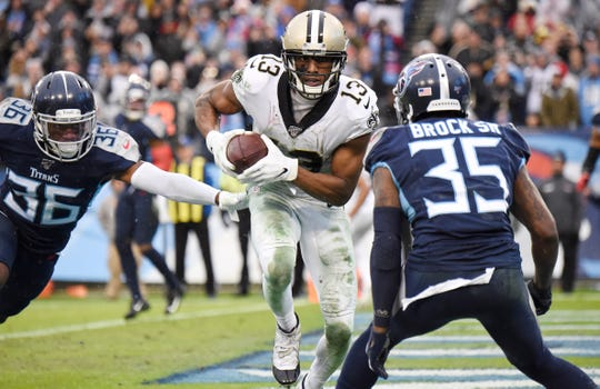 New Orleans Saints wide receiver Michael Thomas (13) scores a touchdown during the fourth quarter against the Tennessee Titans at Nissan Stadium Sunday, Dec. 22, 2019 in Nashville, Tenn. With his 144th catch of the season, Thomas broke Marvin Harrison's single-season reception record set in 2002.