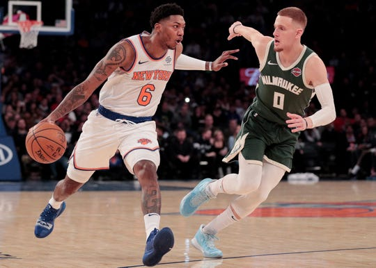Dec 21, 2019; New York, New York, USA;  New York Knicks guard Elfrid Payton (6) drives to the basket as Milwaukee Bucks guard Donte DiVincenzo (0) defends during the first quarter at Madison Square Garden.