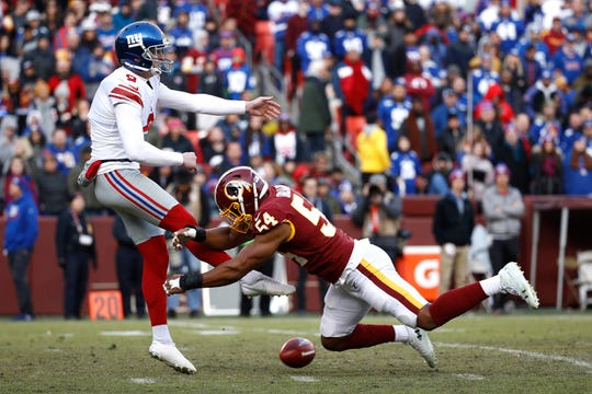 Washington Redskins linebacker Nate Orchard, right, blocks a punt attempt by New York Giants punter Riley Dixon during the second half of an NFL football game, Sunday, Dec. 22, 2019, in Landover, Md. (AP Photo/Patrick Semansky)